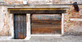 Old and rustic metal doors with decay brick wall building in venice italy Stock Photo