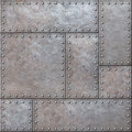 Old rustic metal plates with rivets seamless background or texture Royalty Free Stock Photo