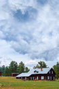 Old Rustic Mountain Cabin Ranch Under Storm Clouds Stock Photo
