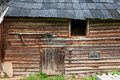 Old rustic timbered barn in the sunny summer day Stock Photos