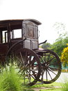 Old rustic vintage hourse-drawn four wheels cab carriage Royalty Free Stock Photo