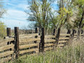Old rustic wooden fence picturesque along the edge of a ranch Royalty Free Stock Images