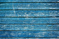 Old rustic wooden planks with blue cracked paint, vintage wall wood for background Royalty Free Stock Photo