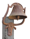 Old rusty bell isolated in a cradle shaped like a long horn steer mounted on a wooden post on white Stock Image