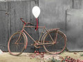 Old rusty bicycle decorated intimate pictures for greetings card on wooden background Stock Images