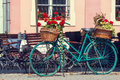 Old rusty bicycle with flowers Royalty Free Stock Photo