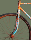 Old rusty bicycle isolated on green Royalty Free Stock Images