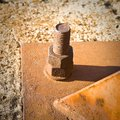 Old rusty bolt with iron plate toned image Stock Image