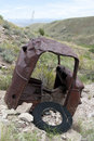 Old rusty car on hill truck cab side of american west Stock Photos