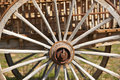 Old rusty cart wheel detail with green background horizontal Royalty Free Stock Photos