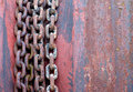 Old rusty chains on rotor the Royalty Free Stock Photo