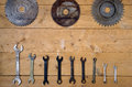 Old rusty circular saw blades and wrenches Royalty Free Stock Photo