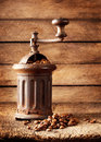Old rusty coffee grinder with beans Stock Photo