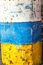 Old rusty colorful barrels in landscape Royalty Free Stock Photography
