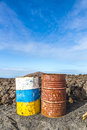 Old rusty colorful barrels in volcanic landscape in timanfaya na national park lanzarote Stock Photo