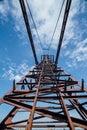 Old rusty crane arrow on blue sky background Royalty Free Stock Photo