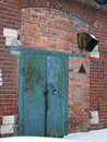 The old rusty door and the brick wall Royalty Free Stock Photo