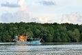 An old rusty fishing trawler returning to harbor Royalty Free Stock Photo