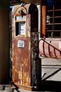 Old Rusty Gas Pump with Interesting Shadows Royalty Free Stock Photo