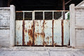 Old rusty gate door factory Royalty Free Stock Image