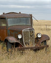 Old rusty grain truck an left to die a slow death in a north dakota field Royalty Free Stock Image