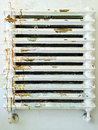 Old rusty heater with peeling paint Stock Image