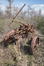 Old rusty iron plow abandoned.