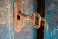 Old rusty key and keyhole on a blue wooden door Royalty Free Stock Photo