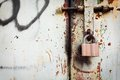 Old rusty lock on grunge metal door Royalty Free Stock Photo