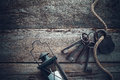 Old rusty lock with keys, vintage lamp, bottle and rope Royalty Free Stock Photo