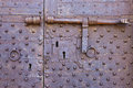 Old and rusty metal door with many keyholes antique latch Stock Image