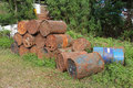 Old rusty metal fuel tanks stacked in a row Royalty Free Stock Images
