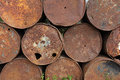 Old rusty metal fuel tanks stacked in a row Royalty Free Stock Image