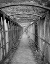 Old rusty metal pedestrian footbridge crossing a railway line Royalty Free Stock Photo
