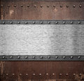 Old rusty metal plate background with rivets Royalty Free Stock Photo