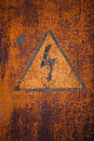Old rusty metal surface with the sign danger high voltage Stock Photo