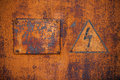 Old rusty metal surface with the sign danger high voltage Stock Image