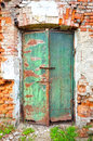 Old rusty metallic door brick wall with Royalty Free Stock Photos