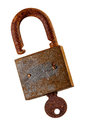 Old rusty padlock and key over white background extreme close up of a lock on Stock Photo