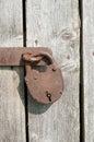 Old rusty padlock on a wooden door Stock Photo