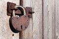 Old and rusty padlock on a wooden door Royalty Free Stock Photo