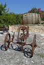 Old rusty plow with a wooden barrel Royalty Free Stock Photography