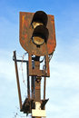 Old rusty railway traffic lights over blue sky Royalty Free Stock Photos