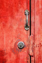 Old rusty red door and brass lock handle Royalty Free Stock Photography