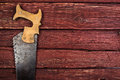 Old rusty saw on wooden background Royalty Free Stock Photos