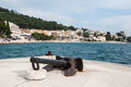 Old rusty ship anchor in the harbor in Podgora, Croatia Royalty Free Stock Photo