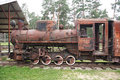 Old rusty steam locomotive antique broken standing on rails Stock Photos