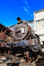 Old rusty steam locomotive in background of the sky Stock Photo