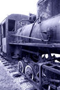 Old rusty steam locomotive closeup of antique broken standing on rails Royalty Free Stock Photo