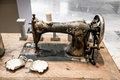 Old rusty vintage sewing machine on wooden table Royalty Free Stock Photo